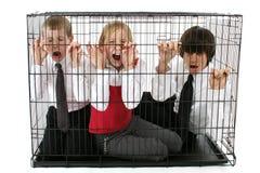 Bambini messi in gabbia Fotografia Stock Libera da Diritti