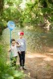 Bambini, natura, famiglia, amore, foresta, avventura, pesca, ragazzo, ragazza Fotografia Stock