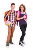 Bambini teenager che ritornano alla scuola Fotografia Stock Libera da Diritti