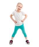 Bambino in abiti sportivi, isolati su fondo bianco Fotografia Stock Libera da Diritti