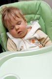 Bambino addormentato in alta presidenza Fotografie Stock
