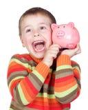 Bambino adorabile con la sua piggy-banca Fotografia Stock Libera da Diritti