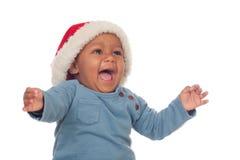 Bambino africano adorabile con gridare del cappello di Natale immagini stock libere da diritti