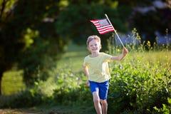 Bambino al quarto luglio Fotografie Stock