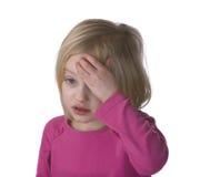 Bambino ammalato con l'emicrania Fotografia Stock