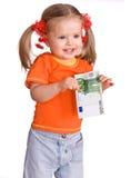 Bambino in arancio con l'euro dei soldi. Fotografia Stock