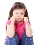 Bambino arrabbiato isolato su bianco Immagine Stock