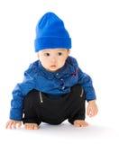 Bambino asiatico che si accovaccia sul pavimento fotografia stock