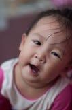 Bambino asiatico della ragazza di sorriso con il fuoco selettivo Fotografia Stock Libera da Diritti