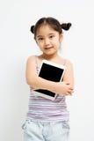 Bambino asiatico felice con il computer della compressa Fotografia Stock Libera da Diritti