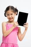 Bambino asiatico felice con il computer della compressa Fotografia Stock
