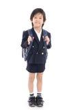 Bambino asiatico in uniforme scolastico con la borsa di scuola blu Immagine Stock Libera da Diritti