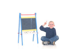 Bambino astuto in aula Fotografie Stock