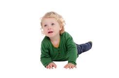 Bambino biondo adorabile che si trova sul pavimento Fotografie Stock Libere da Diritti