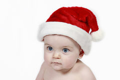 Bambino in cappello del Babbo Natale immagine stock libera da diritti