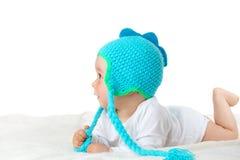 Bambino in cappello del dinosauro Immagini Stock Libere da Diritti