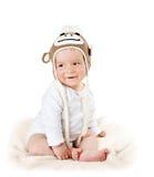 Bambino in cappello della scimmia Fotografia Stock