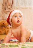Bambino in cappello di natale Fotografia Stock