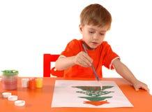 Bambino che dissipa una cartolina di Natale Fotografia Stock