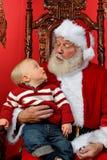 Bambino che esamina in su Santa Fotografia Stock Libera da Diritti