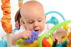 Bambino che gioca con i giocattoli Fotografie Stock