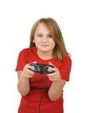 Bambino che gioca i video giochi, immagine stock
