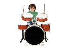 Bambino che gioca un tamburo Fotografia Stock Libera da Diritti
