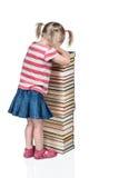 Bambino che grida per i manuali Fotografie Stock