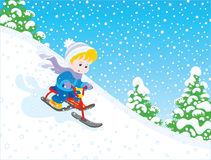 Bambino che guida un motorino della neve Immagini Stock Libere da Diritti