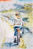 Bambino che guida una bicicletta Fotografia Stock