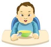Bambino che mangia il suo pasto Immagini Stock Libere da Diritti