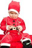 Bambino che porta il vestito della Santa Fotografie Stock
