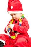 Bambino che porta il vestito della Santa Immagini Stock