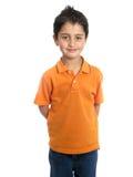 Bambino che sorride e che si leva in piedi isolato Fotografia Stock