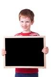 Bambino che tiene una scheda nera Fotografia Stock