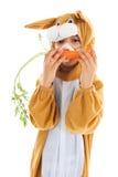 Bambino come lepre di pasqua con le carote Fotografia Stock Libera da Diritti