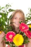 Bambino con boquet dei fiori Fotografia Stock