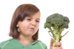 Bambino con broccolo Fotografia Stock Libera da Diritti
