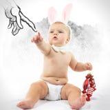 Bambino con Bunny Ears e la caramella Immagini Stock