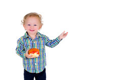 Bambino con frutta Immagine Stock