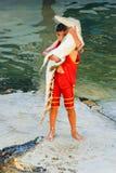 Bambino con i coccodrilli Immagine Stock
