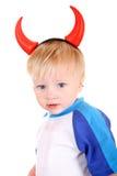 Bambino con i corni del diavolo fotografie stock