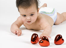 Bambino con i cuori fotografia stock libera da diritti