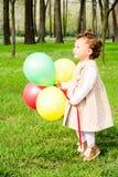 Bambino con i palloni Immagine Stock