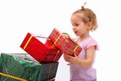 Bambino con i regali Immagini Stock
