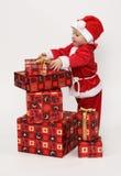 Bambino con i regali di natale fotografia stock