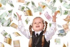 Bambino con i soldi di volo. Fotografia Stock