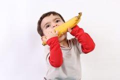 Bambino con il bnana immagine stock libera da diritti