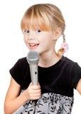 Bambino con il canto del microfono Fotografia Stock Libera da Diritti