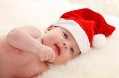 Bambino con il cappello del Babbo Natale Fotografie Stock Libere da Diritti